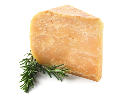 Piece of tasty cheese and rosemary on white background