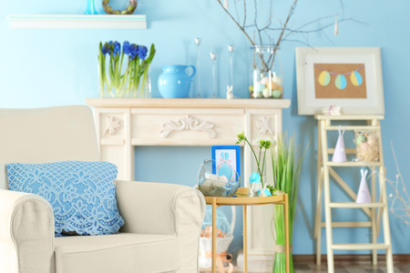 Festive interior of light room decorated with Easter symbols Stock Photo