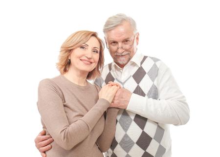Happy senior couple holding hands isolated on white