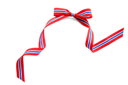 Ribbon bow in colors of Thai flag on white background