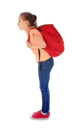 Incorrect posture concept. Cute schoolgirl with backpack on white background Stock Photo