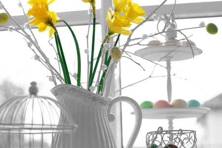 Beautiful bouquet with Easter decorations on blurred background