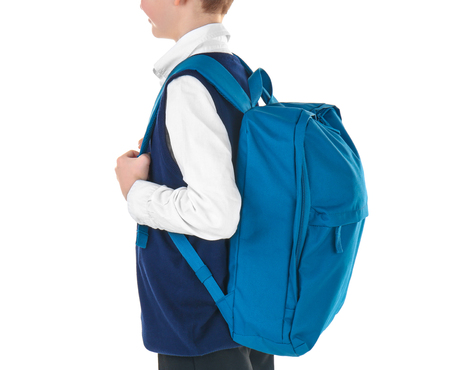 Incorrect posture concept. Cute schoolboy with backpack on white background