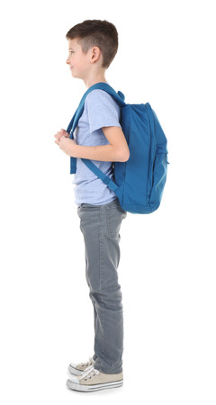 Incorrect posture concept. Cute schoolboy with backpack on white background Stockfoto