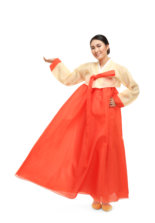 Beautiful young woman in Korean traditional costume on white background