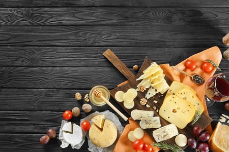 Beautiful composition with variety of cheese on wooden background