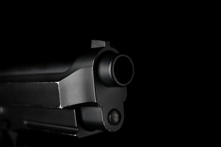 Gun barrel on black background Stock Photo