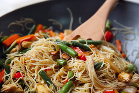 Delicious rice noodle stewing with vegetables on wok Reklamní fotografie