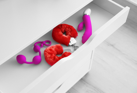 Sex toys in drawer Stock Photo