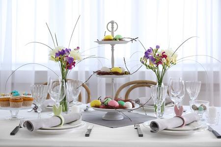 Beautiful Easter table setting in light room Reklamní fotografie