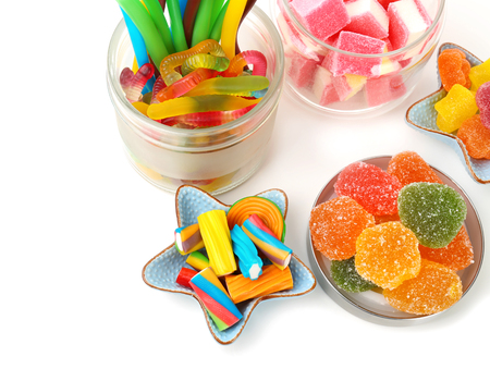 Composition with tasty jelly candies on white background Фото со стока