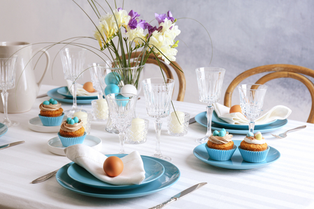 Beautiful Easter table setting with blue plate Reklamní fotografie