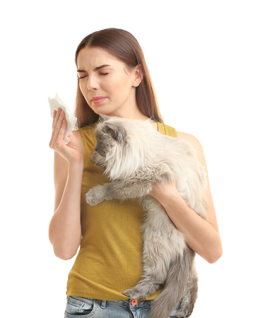 Animal allergy concept. Beautiful woman with cat on white background Фото со стока