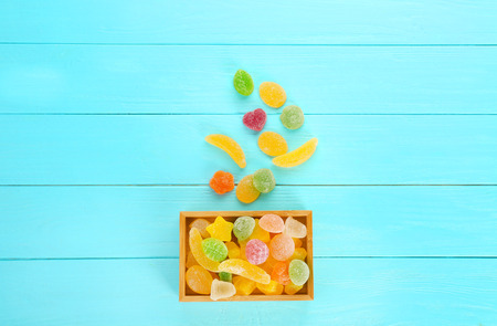 Composition of tasty jelly candies on wooden background Stock Photo