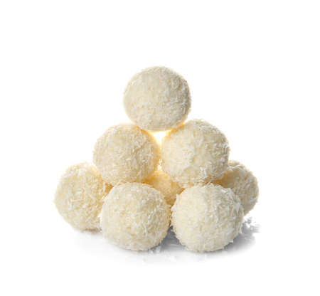 Coconut candies on white background
