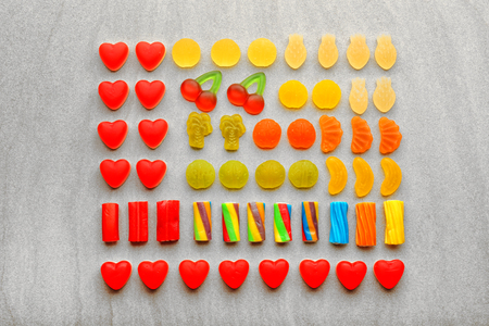 Composition of tasty jelly candies on light background Stock Photo