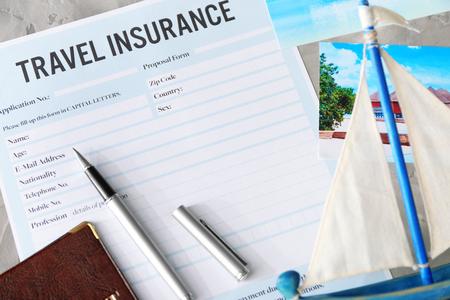 Pen on blank travel insurance form, closeup