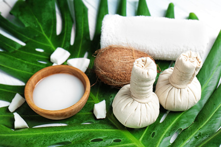 Spa composition with coconut milk on leaf