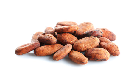 Aromatic cocoa beans on white background