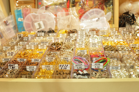 Accessories for handicraft in boxes at shop
