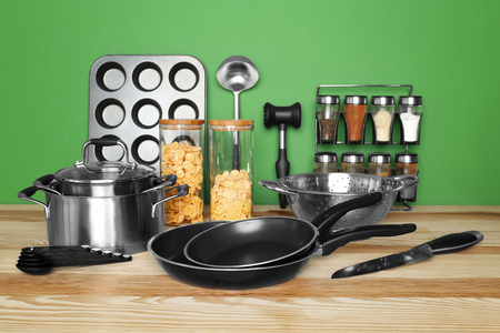 Kitchen utensils and cookware for cooking classes on wooden table Imagens
