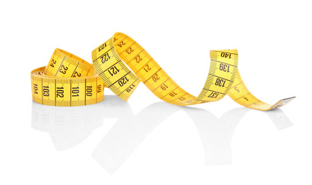 Diet concept. Color measuring tape on white background