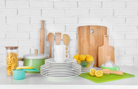 Kitchen utensils and cookware for cooking classes on table
