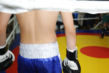 Kickboxing fighter in a ring before competition, closeup