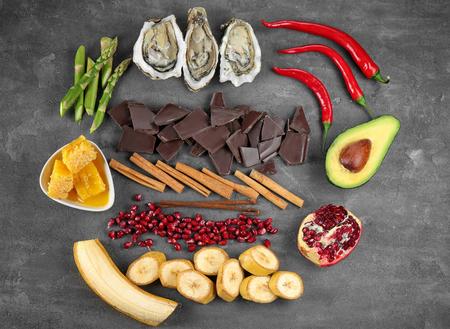 Different aphrodisiac food for increasing sexual desire on gray table 版權商用圖片