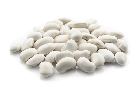 Heap of raw butter beans on white background