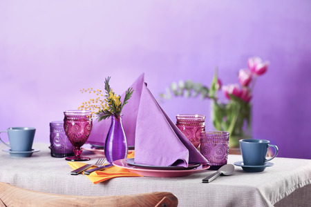 Beautiful table setting on color background Stock Photo