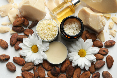 Beautiful composition with cocoa butter products on table Stok Fotoğraf