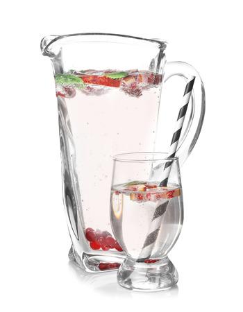 Jug and glass of refreshing lemonade on white background 版權商用圖片
