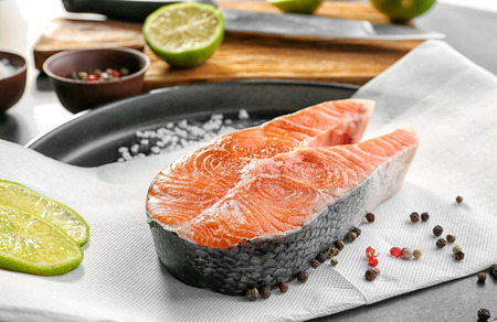 Baking dish with fresh salmon steak and spice, closeup