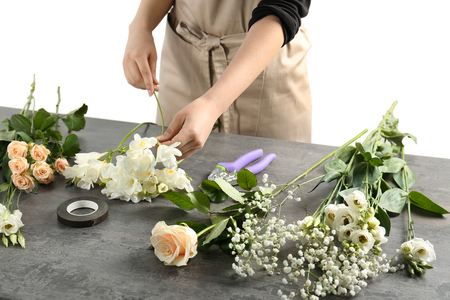 Female florist making beautiful bouquet at flower shop Reklamní fotografie