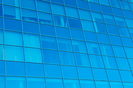 Modern office building with tinted windows, exterior view Archivio Fotografico