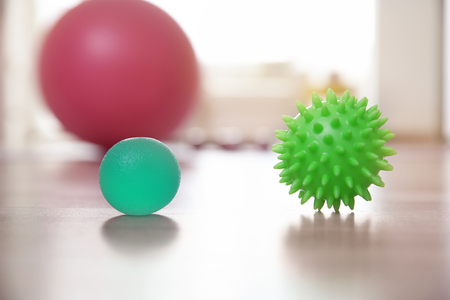 Massage balls on floor indoors Stockfoto