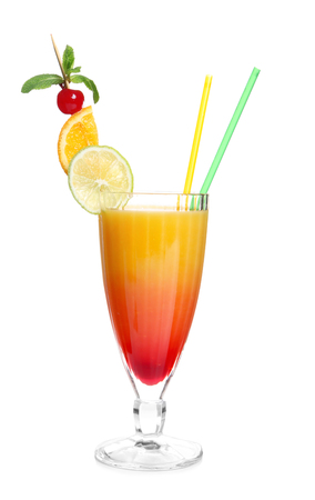Glass of Tequila Sunrise cocktail on white background Фото со стока