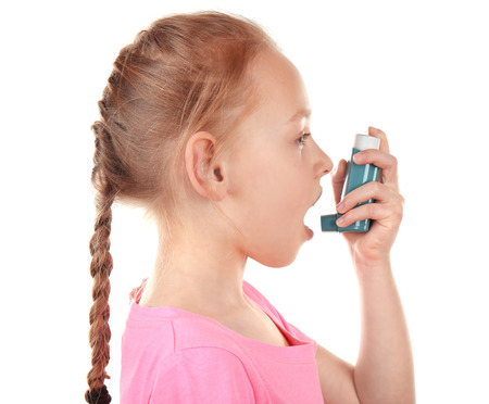 Girl using inhaler during asthmatic attack on white background Banque d'images