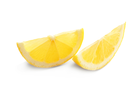Slices of delicious lemon on white background