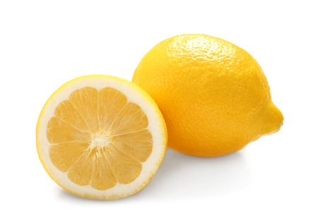 Delicious fresh lemons on white background
