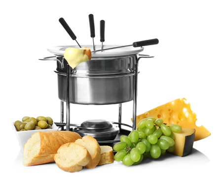 Delicious cheese fondue in pot and products on white background Banque d'images