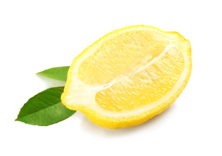 Half of fresh lemon and green leaves on white background