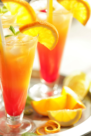 Glasses of Tequila Sunrise cocktail on metallic tray, closeup Stock Photo