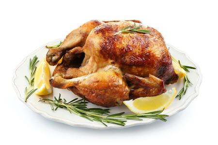 Plate with tasty homemade lemon chicken on white background