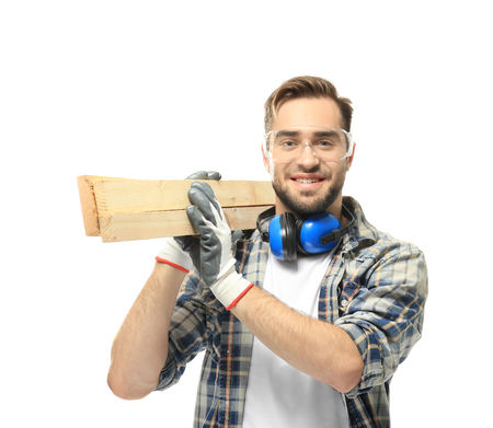 Smiling carpenter holding wooden planks on white background Reklamní fotografie