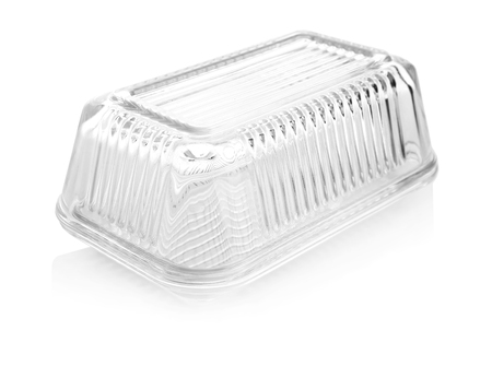 Empty butter dish on white background