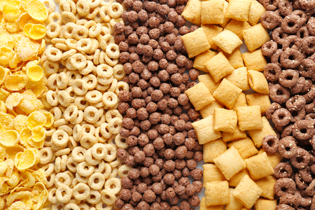 Different healthy breakfast cereals as background