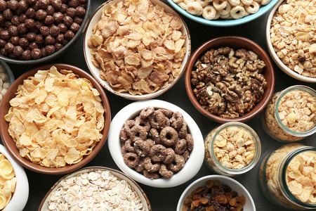 Different healthy breakfast cereals on table
