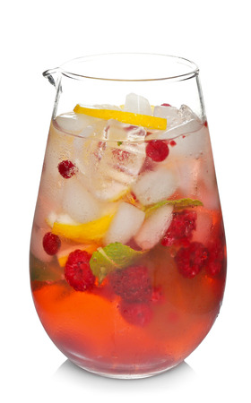 Glass jug of cold lemonade on white background 写真素材